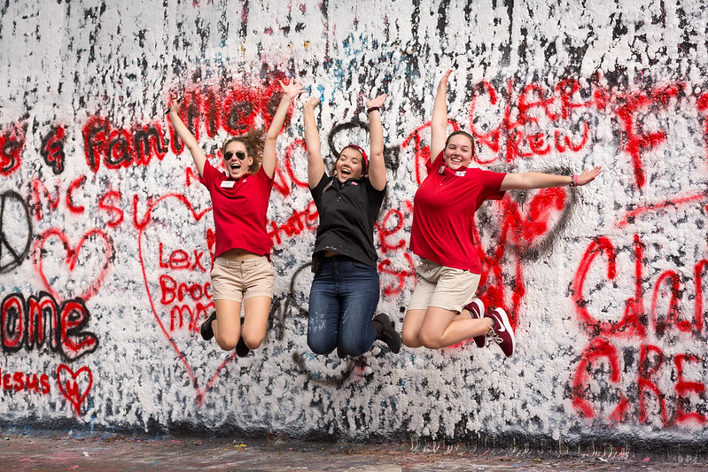 Students jumping in front of the free expression tunnel.
